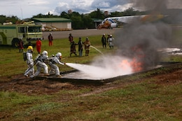 A Puerto Princesa Airport Aircraft Rescue and Fire Fighting team, along with a U.S. Marine ARFF team, put out a training fire on the PPA flight line in Puerto Princesa, Palawan, Republic of the Philippines, April 22, 2012. The fire fighters trained together with U.S. Marines in support of Balikatan 2012 Task Force Palawan. BK12, in its 28th iteration, is a bilateral, joint exercise conducted annually between the Republic of the Philippines and U.S. military members. The U.S. Marines are with Aviation Operations Company, Marine Wing Support Squadron 172, Marine Wing Support Group 17, 1st Marine Aircraft Wing, III Marine Expeditionary Force.