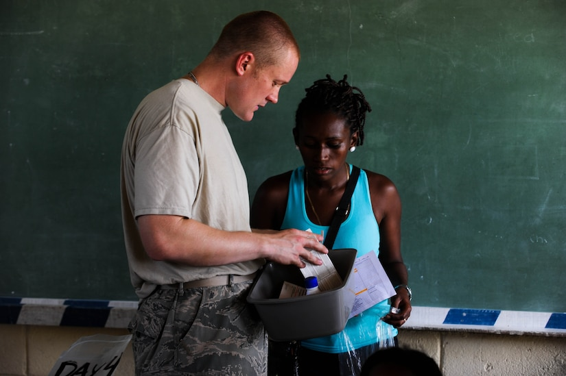 BATALLA, Honduras -- Air Force Staff Sergeant Thomas Delperdang, Medical Element Pharmacy Technician explains to a patient the prescription medication she is receiving with proper instructions on use during JTF-Bravo's most recent medical readiness and training exercise. In partnership with the Honduran Ministry of Health and Honduran Military, JTF-Bravo delivered medical care to 1,774 patients in Batalla and Wawina during the MEDRETE, April 18-21. (U.S. Air Force Photo/1st Lt. Christopher Diaz)