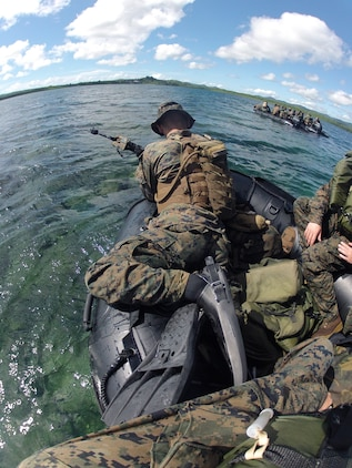 Marines with Company A., Battalion Landing Team::r::::n::1st Battalion, 4th Marines, 31st Marine Expeditionary Unit, ride a combat rubber raiding craft toward a beach here during a mock beach raid, Apr. 25. The raid was one of the last events during Exercise Balikatan, the bilateral training evolution between U.S. forces and the Philippine Marines aimed at improving interoperability and foreign ties. The 31st MEU is the only continuously forward-deployed MEU and remains the nation's force in readiness in the Asia-Pacific region.