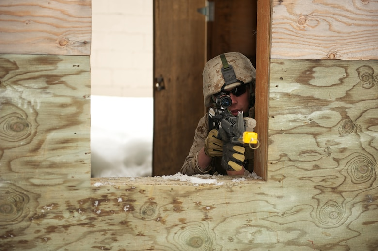 JOINT BASE ELMENDORF-RICHARDSON, Alaska -- Lance Cpl. Cooper Curtis, D Company, Anti-Terrorism Battalion, takes aim April 21 during training in urban operations at JBER's Baumeister City MOUT Complex. (U.S. Air Force photo/David Bedard)