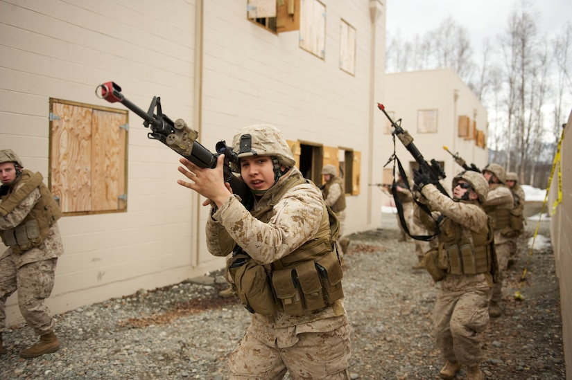 JOINT BASE ELMENDORF-RICHARDSON, Alaska -- Lance Cpl. Jared Palmer, D Company, Anti-Terrorism Battalion, maneuvers at the head of a squad April 21 during training in urban operations at JBER's Baumeister City MOUT Complex. (U.S. Air Force photo/David Bedard)