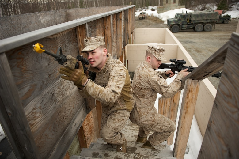 JOINT BASE ELMENDORF-RICHARDSON, Alaska -- D Company, Anti-Terrorism Battalion Marines Lance Cpl. Colton Campbell and Lance Cpl. Eric Whisman clear a rooftop April 21 during training in urban operations at JBER's Baumeister City MOUT Complex. (U.S. Air Force photo/David Bedard)