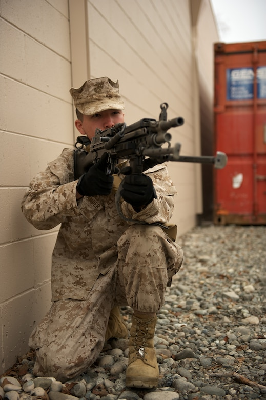 JOINT BASE ELMENDORF-RICHARDSON, Alaska -- Lance Cpl. Matthew Alexander, D Company, Anti-Terrorism Battalion, of Anchorage, provides security April 21 during training in urban operations at JBER's Baumeister City MOUT Complex. (U.S. Air Force photo/David Bedard)