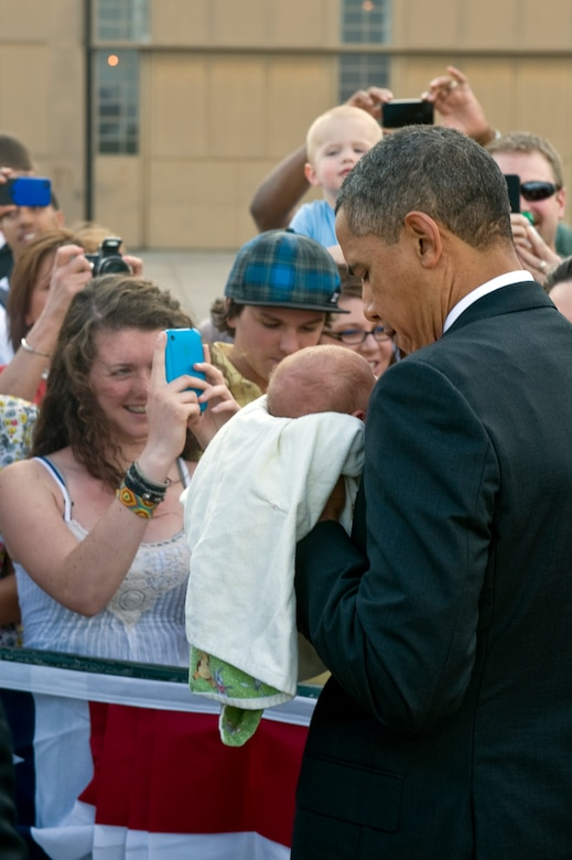 BUCKLEY AIR FORCE BASE, Colo. – President Barack Obama holds a baby from the crowd, here, April 24, 2012. (U.S. Air Force photo by Airman 1st Class Riley Johnson)