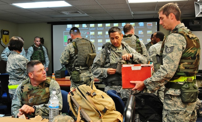 The 644th Combat Communications Squadron members prepare their deployment paper work, their weapons and their gear before heading off to simulated Forward Operating Base Dragon hill April 19. The 644 CBCS is conducting a deployment exercise from April 16 to 27 in order to test their capabilities in a deployed environment and improve their war-fighting capabilities.  (U.S. Air Force photo by Airman 1st Class Marianique Santos)