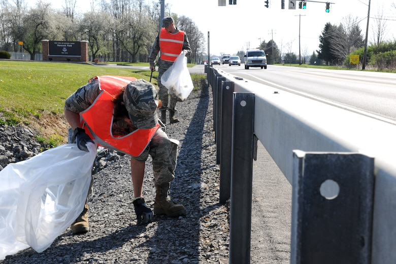 Members of Hancock Field Air National Guard Base, Syracuse, NY clean up trash outside the main gate in support of Earth Day on April 20, 2012.  The participants fanned out from the base and picked up trash in an effort to not only improve the environment but to also act as examples to the community.  (New York Air National Guard Photo by Tech. Sgt. Jeremy M. Call/Released)