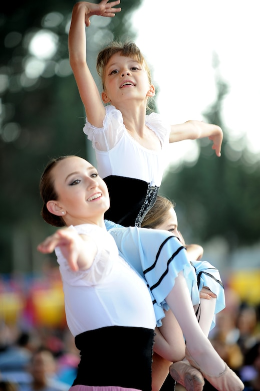 Members of the Incirlik Youth Center perform ballet during a Children's Day festival April 22, 2012, at Incirlik Air Base, Turkey. The event was hosted by the Turkish air force 10th Tanker Base Command and was open to all Turkish and American members of Team Incirlik. The event offered an opportunity for camaraderie and building partnership between Turkish and American service members and civilians. Children's Day is a national holiday that honors Turkish children and the future of the country. (U.S. Air Force photo by Senior Airman Jarvie Z. Wallace/Released)