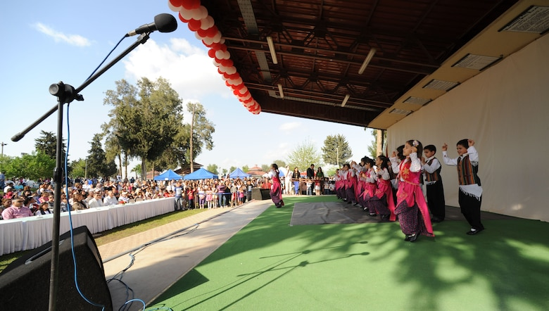 Children's Day festival participants perform a traditional Turkish dance during a festival April 22, 2012, at Incirlik Air Base, Turkey. The event was hosted by the Turkish air force 10th Tanker Base Command and was open to all Turkish and American members of Team Incirlik. The event offered an opportunity for camaraderie and building partnership between Turkish and American service members and civilians. Children's Day is a national holiday that honors Turkish children and the future of the country. (U.S. Air Force photo by Senior Airman Jarvie Z. Wallace/Released)