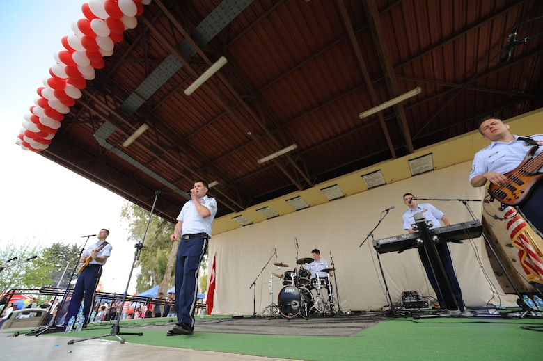 U.S. Air Forces in Europe rock band Touch 'n Go performs during a Children's Day festival April 22, 2012, at Incirlik Air Base, Turkey. The event was hosted by the Turkish air force 10th Tanker Base Command and was open to all Turkish and American members of Team Incirlik. The event offered an opportunity for camaraderie and building partnership between Turkish and American service members and civilians. Children's Day is a national holiday that honors Turkish children and the future of the country. (U.S. Air Force photo by Senior Airman Jarvie Z. Wallace/Released)