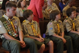 Members of Camp Pendleton's Boy Scout Troop 790 sit front-row at a Court of Honor ceremony, April 24. Prior to the ceremony, Eagle Scout Connor F. Stotts was presented the coveted Boy Scouts of America 'Honor Medal with crossed palms'. Stotts was awarded the medal in recognition for single handedly saving the lives of three swimmers, July 31, 2011.