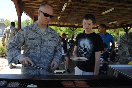 Senior Airman David Collins makes burgers and hot dogs at Eagle Harbor Ranch in Summerville April 12. The Eagle Harbor Ranch has been open since 2004. Collins is from the 437th Maintenance Squadron. (U.S. Air Force photo/Airman 1st Class Chacarra Walker)