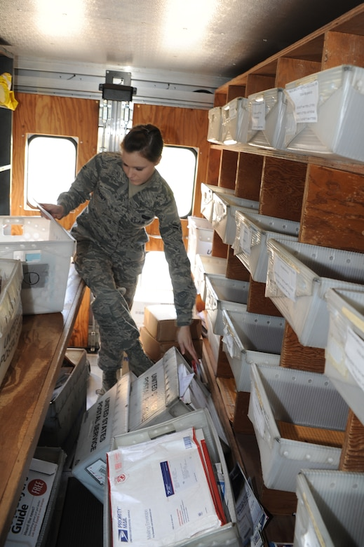 Airman 1st Class Jessalyn Oglesby organizes mail at Joint Base Charleston - Air Base April 10. The 628th Communications Squadron processes 100 to 200 pieces of official mail everyday. Oglesby is a 628th CS knowledge operation management journeyman. (U.S. Air Force photo/ Airman 1st Class Chacarra Walker)