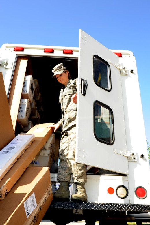 Airman 1st Class Jessalyn Oglesby delivers packages at Joint Base Charleston - Weapons Station April 10. The 628th Communications Squadron mail room at Joint Base Charleston -Air Base is also responsible for the Naval Weapons Station mail center. Oglesby is a 628th CS knowledge operations management journeyman. (U.S. Air Force photo/ Airman 1st Class Chacarra Walker)