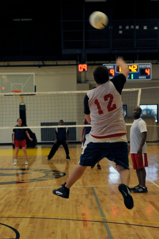 Jared Henley, spiker for the 19th Force Support Squadron, serves the ball during an intramural volleyball game between the 19th FSS and the 19th Medical Group, April 24, 2012, at Little Rock Air Force Base, Ark. The 19th FSS won both games  the 19th 25-15 and 25-16. (U.S. Air Force photo by Airman 1st Class Rusty Frank)