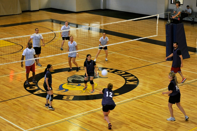 The 19th Force Support Squadron and the 19th Medical Group square off during the an intramural volleyball game, April 24, 2012, at Little Rock Air Force Base, Ark. The 19th FSS won both games 25-15 and 25-16 . (U.S. Air Force photo by Airman 1st Class Rusty Frank)