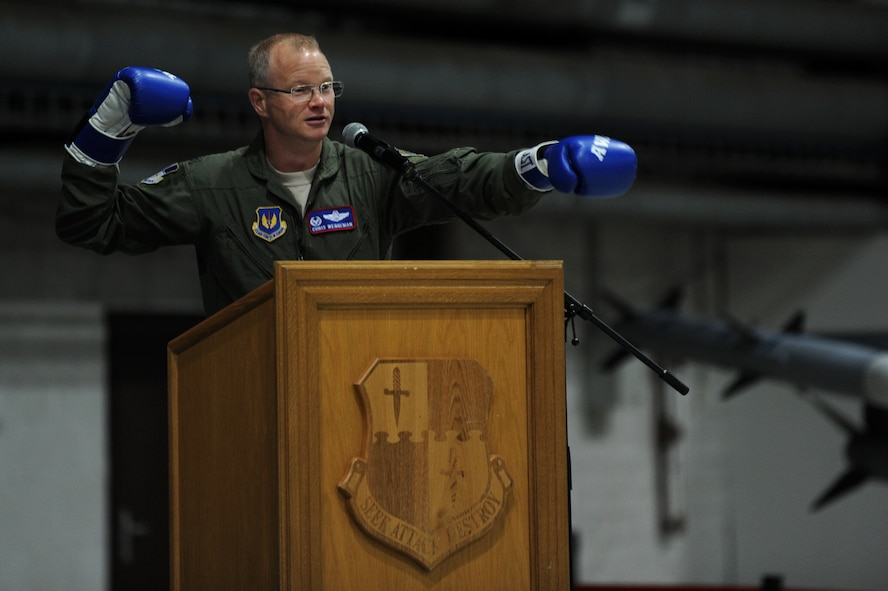 "SPANGDAHLEM AIR BASE, Germany – Col. Chris Weggeman, 52nd Fighter Wing commander, uses boxing gloves to help illustrate the topic of his speech ""Fly, Flight, Win"" during the 2011 Maintenance Professional of the Year banquet at Hangar 1 here April 21. Airmen from the 52nd Maintenance Group and 52nd Munitions Maintenance Group attended the banquet to recognize contributions made by maintenance professionals to mission readiness throughout the year. The banquet also included awards for Airmen and teams who went above and the beyond the established standards for their job performance. (U.S. Air Force photo by Airman 1st Class Matthew B. Fredericks/Released)"