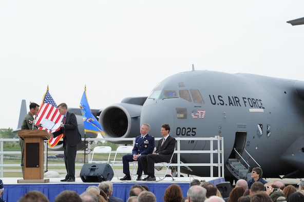 "DAYTON, Ohio -- Col. Douglas Jaquish, Vice Commander of the Air Force Flight Test Center, Edwards AFB, Calif., ""hands over"" the U.S. Air Force's first C-17 (T-1) to Lt. Gen. (Ret.) Jack Hudson, director of the National Museum of the U.S. Air Force. The C-17 arrived at the museum after its final flight on April 25, 2012. (U.S. Air Force photo by Jeff Fisher)"