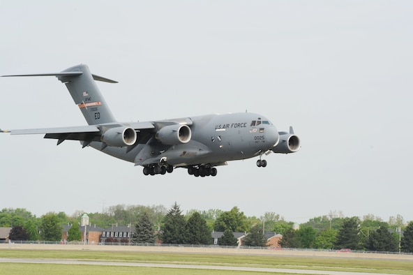DAYTON, Ohio -- The U.S. Air Force's first C-17 (T-1) arrives at the National Museum of the U.S. Air Force after its final flight on April 25, 2012. This C-17 Globemaster III (S/N 87-0025) was essentially hand-built for the sole purpose of developmental test and evaluation, with an estimated life span of approximately five years. The aircraft was periodically rebuilt and refurbished over the years and its lifespan grew from five to 21 years. (U.S. Air Force photo by Jeff Fisher)