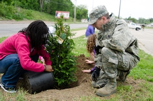 Capt. Allen Bear, 139th Environmental Management Officer, helps plant a tree during an Earth Day event April 27, 2012 in St. Joseph, Mo. The 139th Airlift Wing donated 14 trees which were planted by the St. Joseph Parks and Recreation Department and students from Mark Twain Elementary School. (U.S. Air Force photo by Staff Sgt. Michael Crane/Missouri Air National Guard)