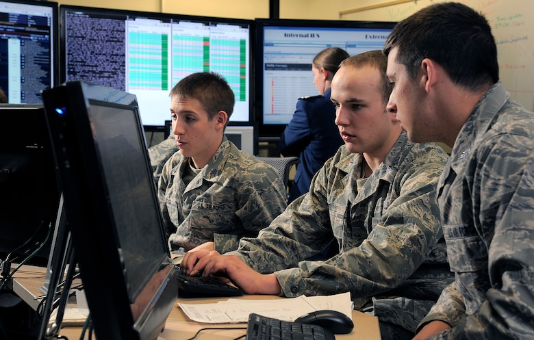 Cadet 1st Class Jordan Keefer, center, coordinates cadet efforts to defend their network during the National Security Agency's Cyber Defense Exercise April 17, 2012. The Air Force Academy team took first place in the competition, outscoring the other U.S. service academies as well as two post-graduate Air Force Institute of Technology teams. (U.S. Air Force photo/Raymond McCoy)