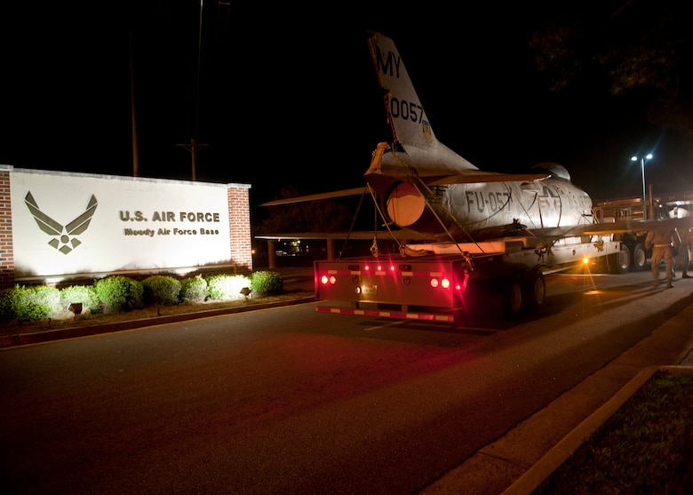 An F-86L Sabre arrives at Moody Air Force Base, Ga., after being transported from downtown Valdosta, Ga., April 25, 2012. Several city and base agencies assisted in the relocation, to include: Moody civil engineer squadron, security forces squadron, crash recovery, Lowndes County and Valdosta Sheriff's Department, and Valdosta utility departments. Varying equipment was used to safely and securely transport the aircraft. (U.S. Air Force photo by Senior Airman Eileen Meier/Released)