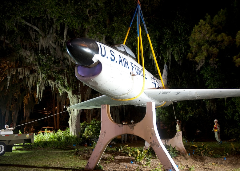 An F-86L Sabre is lifted off its mount in downtown Valdosta, Ga., and onto a flatbed trailer April 24, 2012. The historic aircraft is being moved to Moody Air Force Base, Ga., where it will be restored and displayed at the George W. Bush Air Park at Moody Field. (U.S. Air Force photo by Senior Airman Eileen Meier/Released)