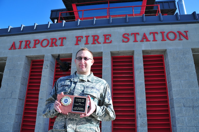 Tech. Sgt. Carl Merriman holds his award for Exchange Club Firefighter of the Year. The prestigious annual award is given to the most deserving firefighter from the MTANG, Malmstrom Air Force Base and the city of Great Falls.  (U.S. Air Force photo by Master Sgt. Jason Johnson)