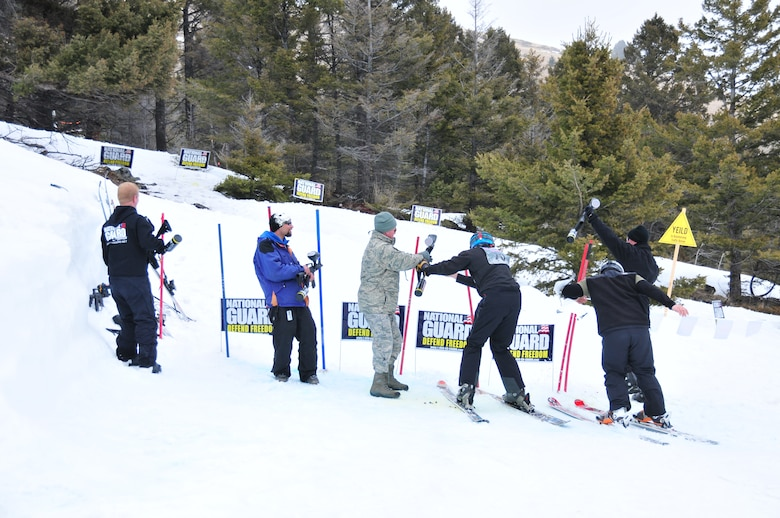 Montana Air National Guard Recruiter Tech. Sgt. Andy English (center) assists a participant competing in the biathlon event during the Park Riders Roundup held at the Great Divide Ski Area March 24, 2012. (U.S. Air Force photo by Staff Sgt. Michael Touchette)