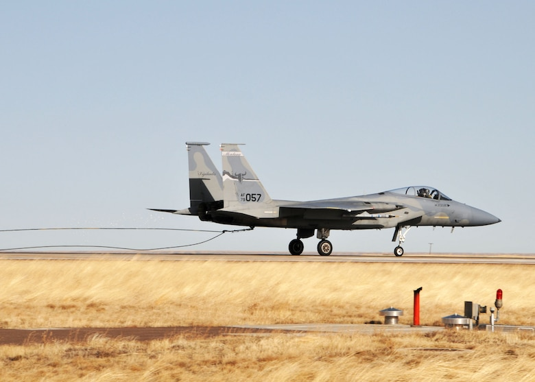 A Montana Air National Guard F-15 Eagle catches the aircraft arresting cable of the Barrier Arresting Kit 12/14 cable with its tail hook during the certification engagement exercise held at the Great Falls International Airport on March 4, 2012. (U.S. Air Force photos by Senior Master Sgt. Eric Peterson)