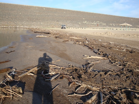 This photo of debris accumulating on the beach at Cochiti Lake was taken April 10, 2012, and shows the volume and type of material flowing into the lake since last year's wild fires.