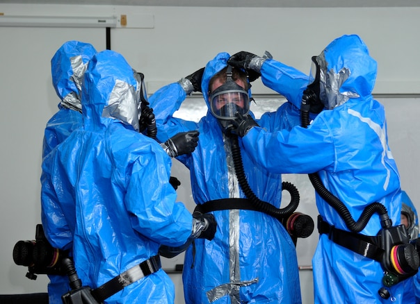 Members of the 151st Air Refueling Wing Medical Group don their hazardous material suits for training during the Great Utah Shakeout earthquake drill April 17, 2012, at Camp Williams, Utah.  (U.S. Air Force Photo by Tech. Sgt. Jeremy Giacoletto-Stegall/Released)