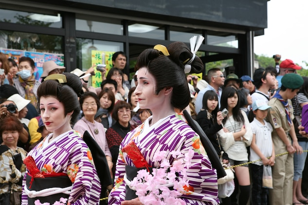 Two station residents, dressed as lady followers, walk in the final gala across the Kintai Bridge and through Kintai park April 29, 2012 as part of the Sankin-kotai, the Daimyo's annual March through Edo. During the age of Feudal Japan, each Daimyo (Japanese feudal lord) was required by the Tokugawa Shogunate to reprt at least every other year in the capital city of Edo, now Tokyo.
