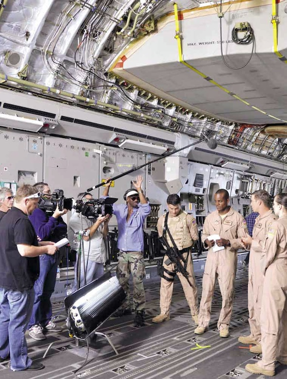Actors portray a C-17 crew who landed into a hostile environment staged in Southern Sudan, discussing how to best handle the situation. (U.S. Air Force photo by SSgt Megan Crusher)