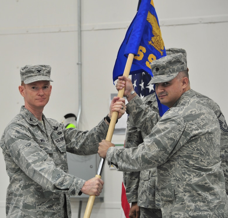 U.S. Air Force Col. William West, 27th Special Operations Group commander, passes the guidon to Lt. Col James Chappelear, 56th Special Operations Intelligence Squadron commander during the 56 IS inactivation ceremony at Cannon Air Force Base, N.M., April 27, 2012.The passing of the guidon signifies the change in command. (U.S Air Force photo Airman 1st Class Xavier Lockley)