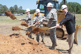 (From left to right) Col. Patrick Mahaney Jr., Lt. Col. Jack Haefner, Col. Paul Olsen and Mike McCarthy throw dirt during a groundbreaking ceremony for the new Asymmetric Warfare Group's battle laboratory complex at Fort A.P Hill, Va.  April 25, 2012.  The $55 million dollar complex, construction of which is overseen by the Norfolk District, U.S. Army Corps of Engineers, will provide the Army with an area to test and adapt operating procedures to ever-changing wartime scenarios.  (U.S. Army photo/Patrick Bloodgood)