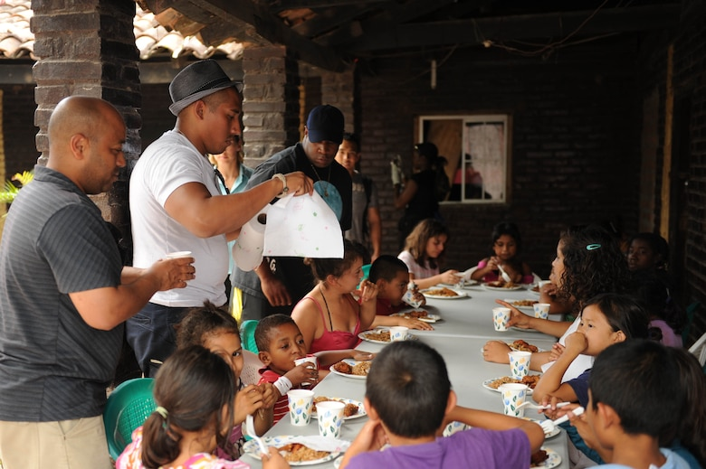 Members of Joint Task Force-Bravo at Soto Cano Air Base, Honduras, provide food for and play with children at a local orphanage July 1, 2012. Units across JTF-Bravo sponsor various orphanages in the area and visit them frequently throughout the year. (U.S. Air Force photo/1st Lt. Christopher Diaz)