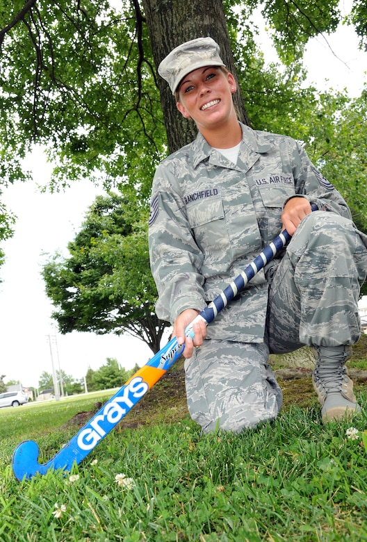 Tech. Sgt. Kate Blanchfield, 512th Airlift Wing commander support staff, poses with her field hockey stick on Dover Air Force Base, Del. July 15, 2012. Blanchfield, a reservist for nearly 10 years, has played competitive field hockey since age 12. (U.S. Air Force photo by Staff Sgt. Andria J. Allmond)