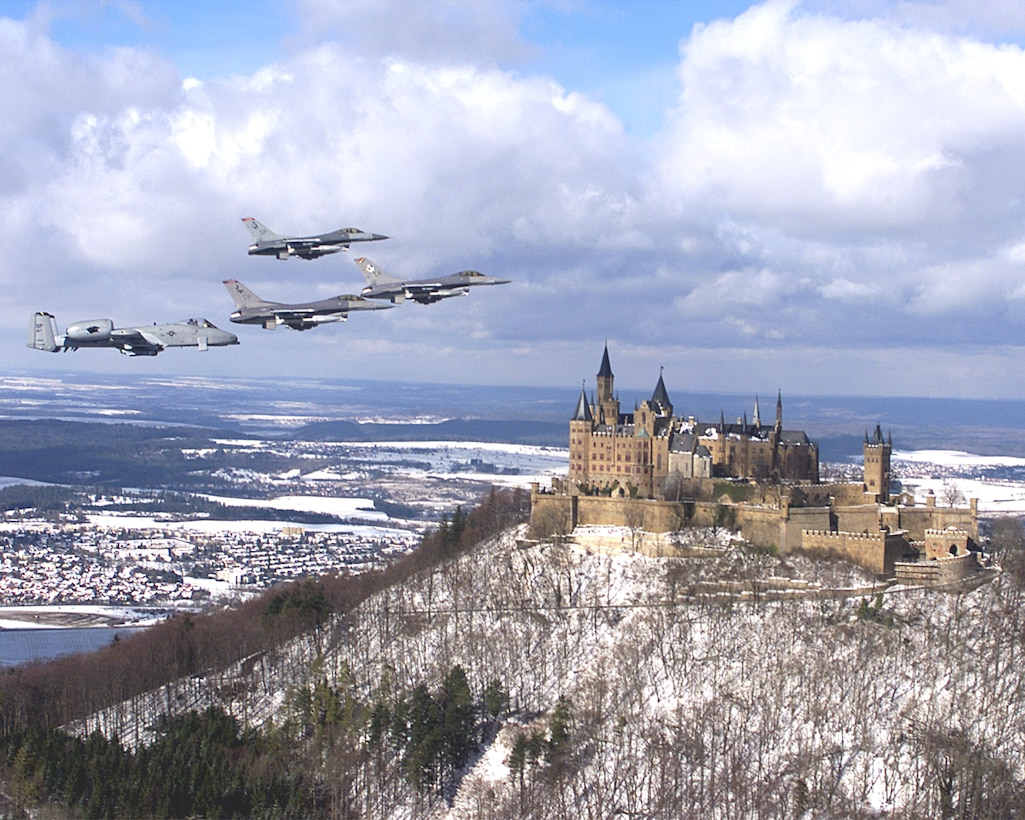 U.S. Air Force F-16 Fighting Falcons fly above Burg Hohenzollern, located atop Mount Hohenzollern in Baden-Wuerttemberg. The castle is open for tours throughout the year. For more information, visit http://www.burg-hohenzollern.com/startseite.html. (U.S. Air Force courtesy photo/Released).