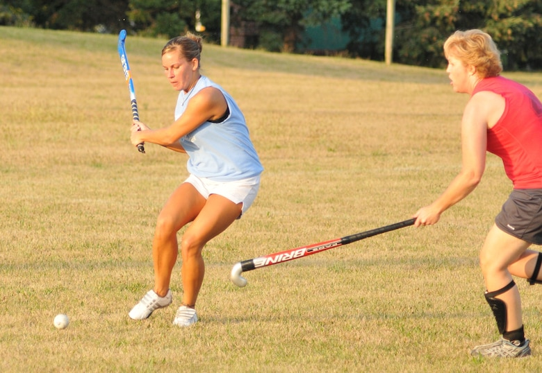 Kate Blanchfield drives a ball toward the goal during her team's July 22, 2012, win in a Dover, Del., adult field hockey league. The 512th Airlift Wing technical sergeant  has played the sport for 15 years. (U.S. Air Force photo by Chief Master Sgt. Matt Proietti)