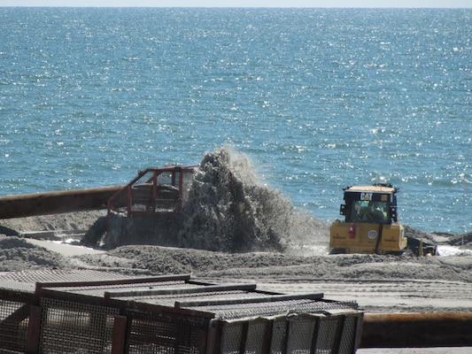 Sand and water are pumped through a basket during a Coastal Storm Damage Reduction project on the New Jersey shore. The project is designed to reduce damages to the community and infrastructure.