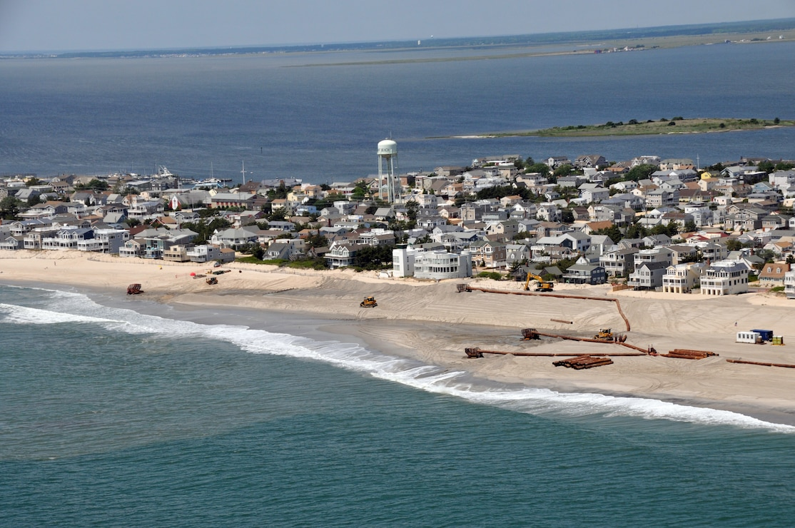 An aerial photograph captures contractors completing the Brant Beach storm damage reduction project in 2012. The beachfill work is designed to reduce storm damages to infrastructure.