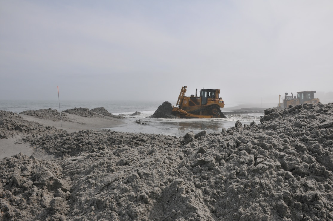 Bulldozers push sand into a berm and dune system at Brant Beach, NJ in 2012 as part of the Long Beach Island beachfill project.