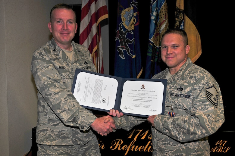 The 171st Air Refueling Wing recognizes Master Sgt. Mike Duganieri's contributions to safety and mishap prevention with a Pennsylvania Meritorious Service Medal August 3.  (National Guard photo by Master Sgt. Ann Young/ Released)