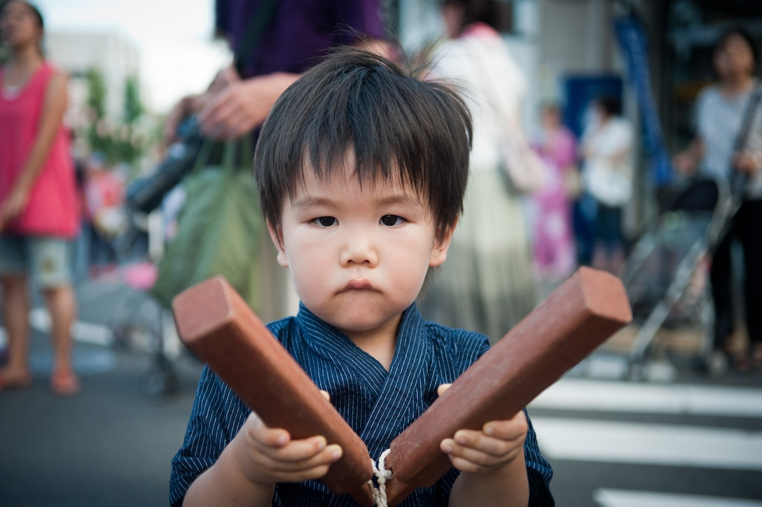FUSSA CITY, Japan -- A Japanese child uses a hyoshigi, a wooden clapper, during the Tanabata Festival in Fussa City, Japan, on Aug. 3, 2012. This year marked the 62nd annual Tanabata Festival in Fussa, and it attracts people from all over the surrounding area. (U.S. Air Force photo by Airman 1st Class John D. Partlow)
