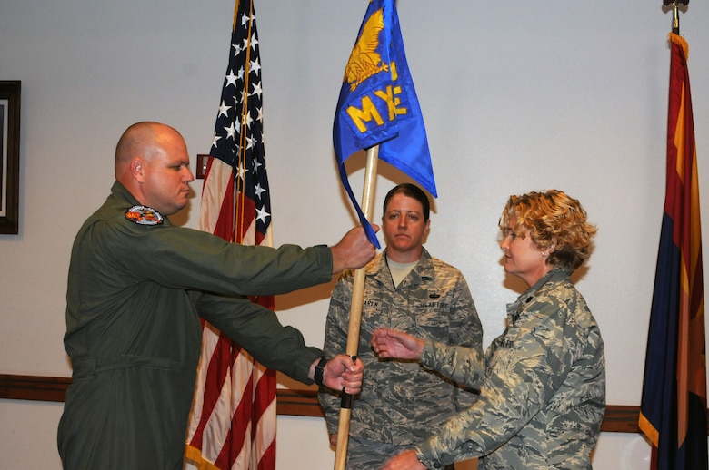 """In a ceremony presided over by Col. Gary Brewer Jr., 161st Maintenance Group commander, Lt. Col. Aimee Storm assumed command of the 161st Maintenance Squadron.  Colonel Storm recently concluded an active duty tour in Germany where she served as an Operational Decision Support officer at United States European Command and the Force Support Squadron commander at the 52nd Fighter Wing at Spangdahlem Air Base, Germany.   After enlisting in June 1990 into a consolidated air maintenance squadron in the Ohio Air National Guard as a munitions systems specialist, she transferred to the Colorado Air National Guard and became additionally qualified in munitions operations. In 1993, she transferred to the Arizona Air National Guard and commissioned as a personnel officer at the 161st Air Refueling Wing in 1995.   Colonel Storm's officer assignments also include services flight commander, homeland security coordinator, and military personnel management officer.   """"For many years I have wanted to get back into maintenance."""" Colonel Storm said. """"To me, this assignment is like coming home."""" (U.S. Air Force photo by Tech. Sgt. Susan Gladstein/Released)"""
