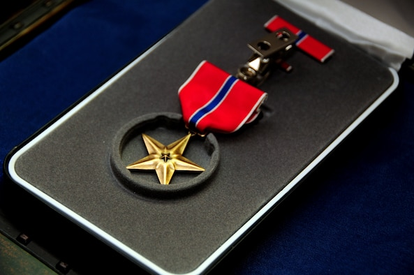 The Bronze Star was presented to Senior Master Sgt. Doug Margelony, assigned to the 103rd Civil Engineer Squadron, Bradley Air National Guard Base, East Granby, Conn., May 5, 2012. The Bronze Star is a United States Armed Forces individual military decoration that may be awarded for bravery, acts of merit, or meritorious service. (U.S. Air Force photo by Tech. Sgt. Tedd Andrews/Released)