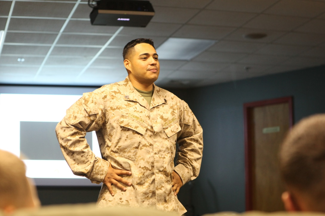 Sgt. Darwin Cornejo listens to a student while teaching Never Leave a Marine Behind aboard Marine Corps Base Camp Lejeune Aug. 2. Cornejo thought several classes to junior Marines and noncommissioned officers from Headquarters and Support Battalion.
