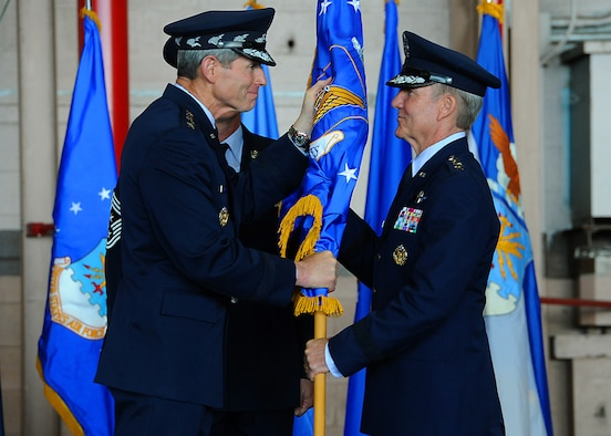"Air Force Chief of Staff Gen. Norton Schwartz presents the Pacific Air Forces flag to new PACAF commander Gen. Herbert ""Hawk"" Carlisle, signifying the transfer of command at Joint Base Pearl Harbor-Hickam, Hawaii, Aug. 3, 2012. Carlisle is the successor to Gen. Gary North, who took command of Pacific Air Forces in August 2009. (U.S. Air Force photo/Tech. Sgt. Jerome S. Tayborn)"