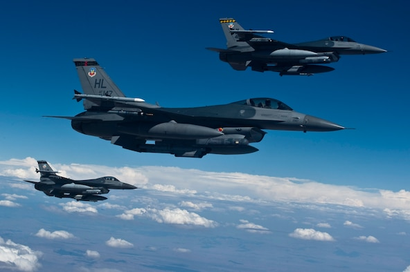 A three-ship of F-16 Fighting Falcons from the 421st Fighter Squadron, Hill Air Force Base, Utah, participate in Red Flag 12-4 July 20, 2012, over the Nevada Test and Training Range. The 421st FS prepares to deploy worldwide to conduct day/night air superiority and precision strike sorties employing laser-guided and inertially aided munitions during contingencies and combat. (U.S. Air Force photo by Airman 1st Class Daniel Hughes/Released).