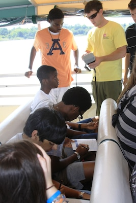 SAVANNAH, Ga. — Jason Lavecchia, a hydraulic engineer with the U.S. Army Corps of Engineers Savannah District, shows a class of Jenkins High School students how to read measurements taken by a water quality probe in the Savannah Harbor, July 25, 2012.
